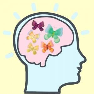 Kopf mit Schmetterlingen im Gehirn